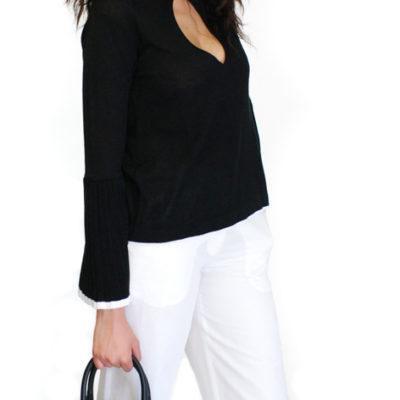 Pantalone bianco in lino e borsa Armani jeans